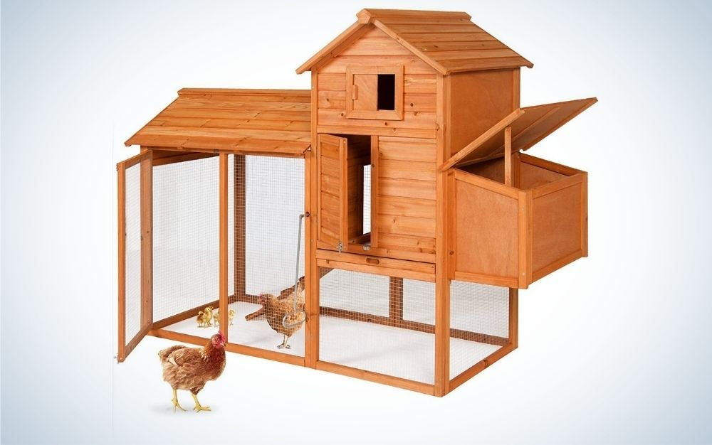 Brown wooden chicken coop with nesting box and wire fence