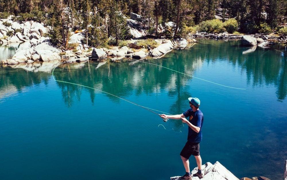 A man casts a fly rod.