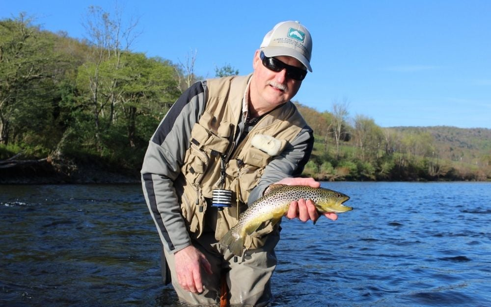 Man catching fish on a fly fishing rod and reel combo