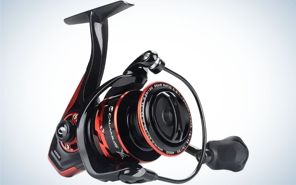 A very complex spinning reel in the form of a machine with different shapes but all in red and black.