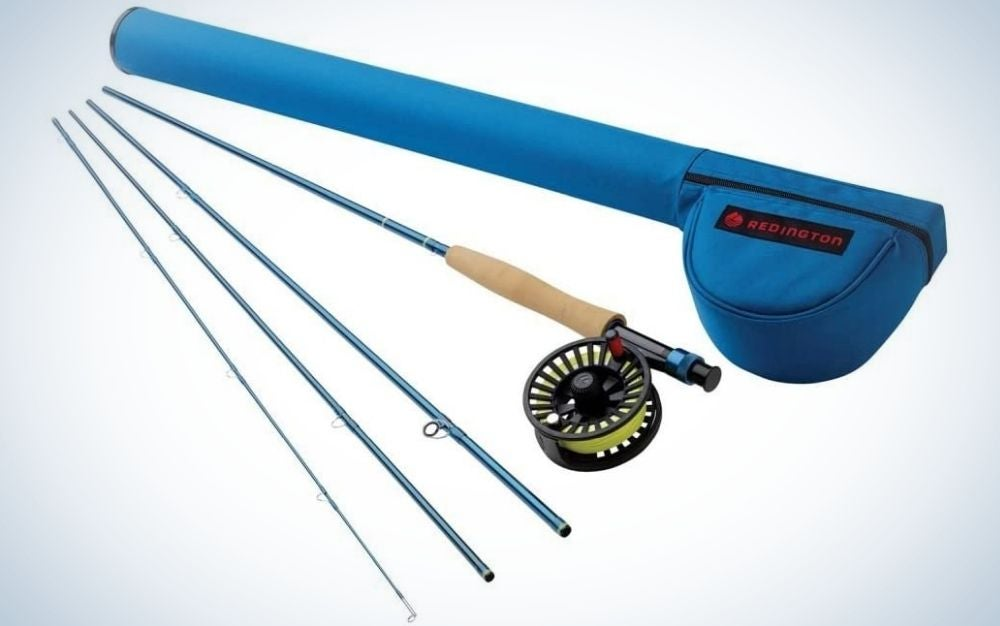 A fishing bait with a color metal and wood sticks as well as three thin silver sticks, and a blue bag for their entire set.