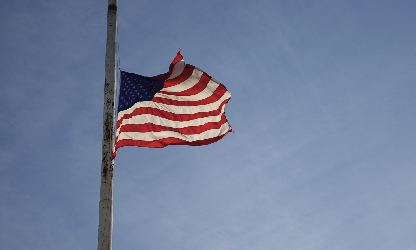 An American flag at half-mast in honor of Memorial Day.