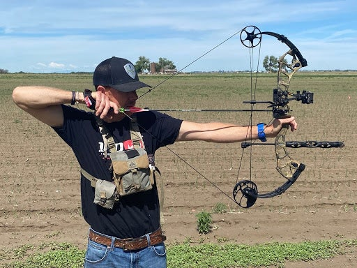 Man at full draw with compound bow