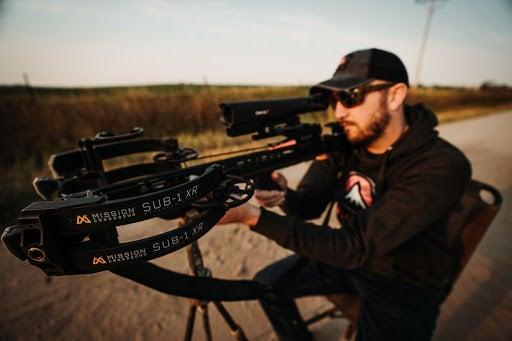 Man shooting Mission Sub-1 crossbow