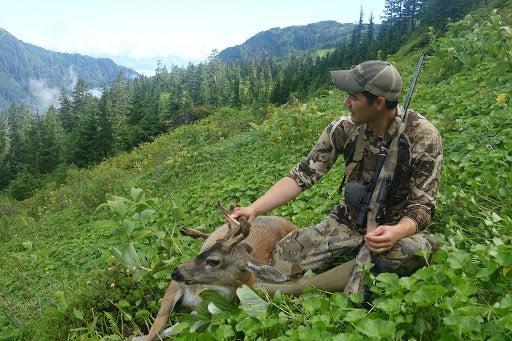 Hunter with hunting gear in Alaska