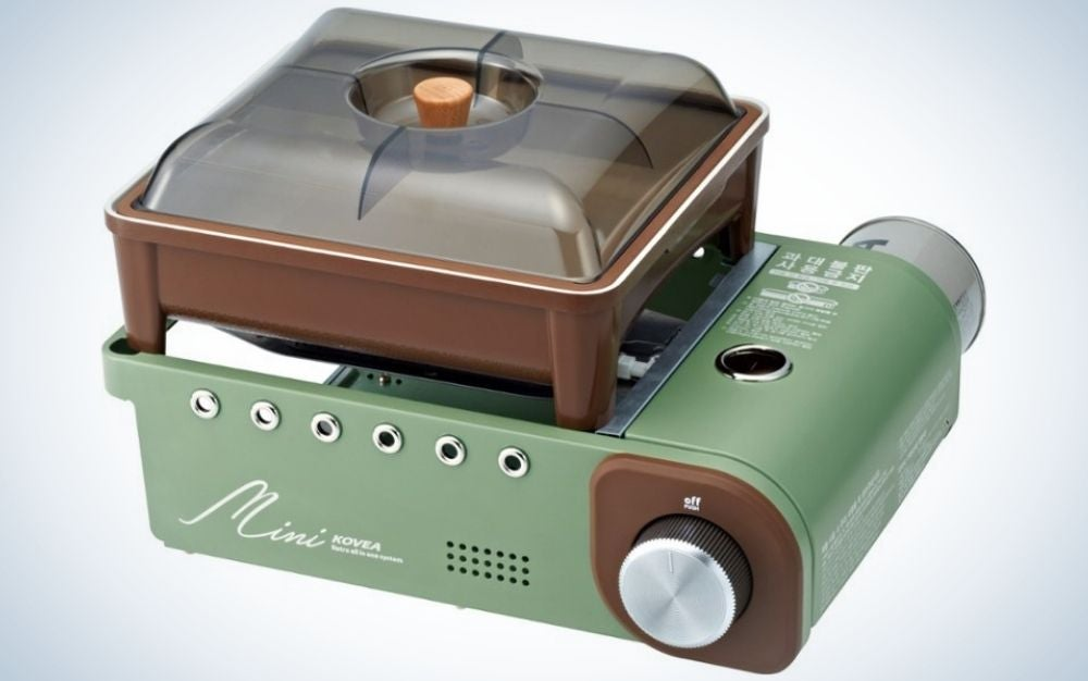 Green and brown mini stove with a handy lid that doubles as a plate or bowl for unique father's day gifts