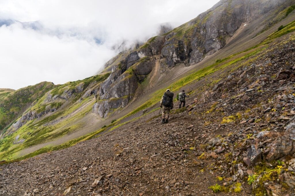 Hiking with backpacking tent while mountain goat hunting.
