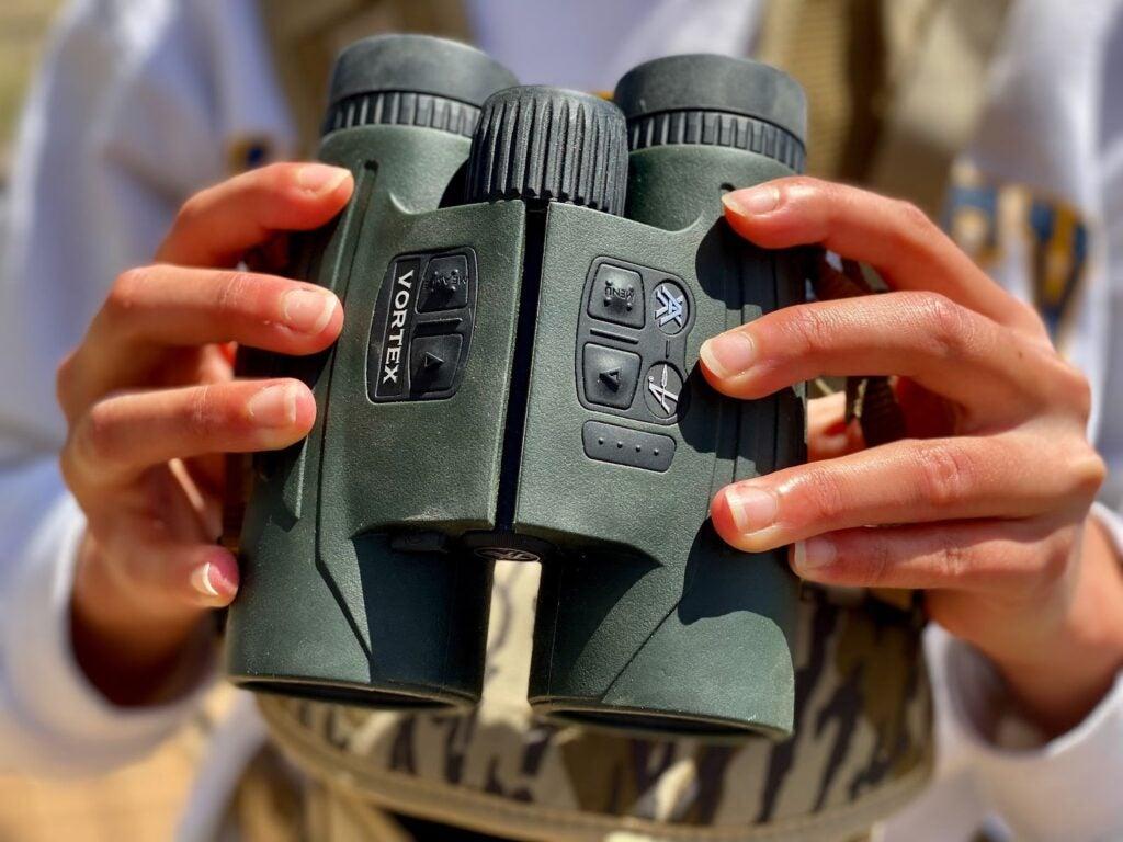 Holding the Vortex Fury HD 5000 AB rangefinding binoculars at the ready.