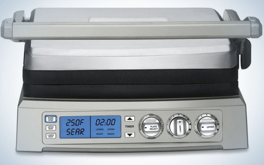 A silver and rectangular cuisinart griddler with some moving buttons and numbers on them.
