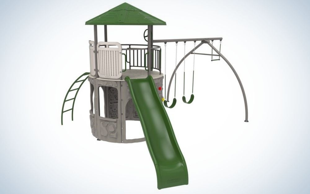 A small brown and green playground with several climbing ladders and sliding from the front.