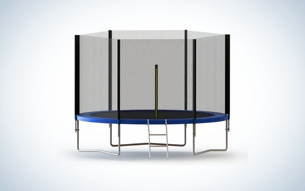 A circular trampoline with a black net and some silver metal legs and a few steps below it.