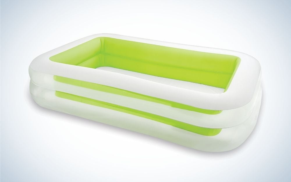 A large commode or outdoor pool in white with an oval shape.