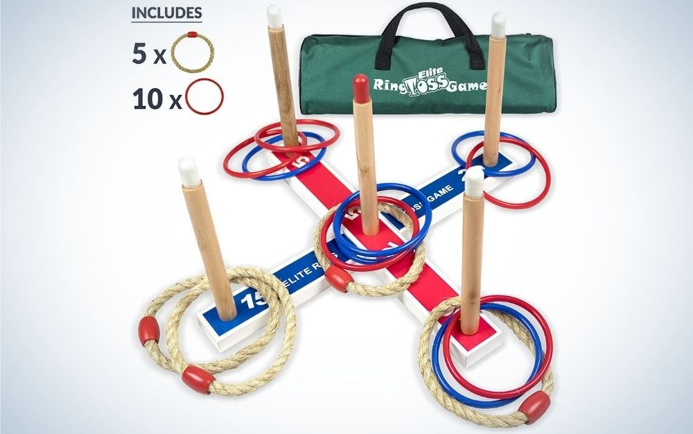 Five wooden sticks and some different colored circles placed inside them, as well as a large green bag next to them.