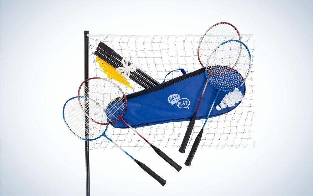 A tennis net one bag and four tennis sticks.