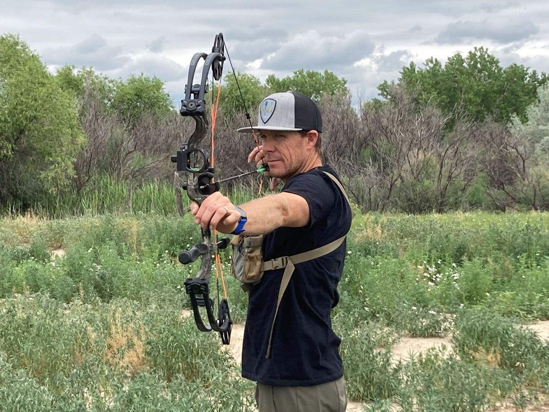 guy shooting bow