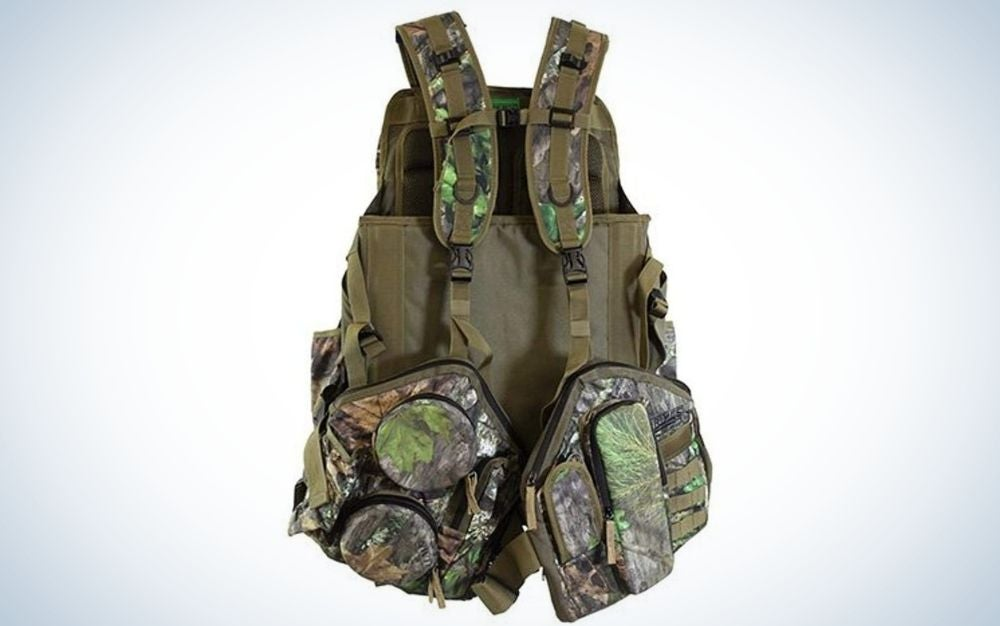 A jacket in the shape of a bag with two military-colored arms and many pockets both on the front and side.