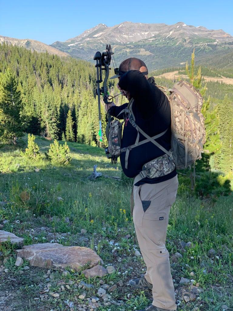 Hunter shooting at 3D target