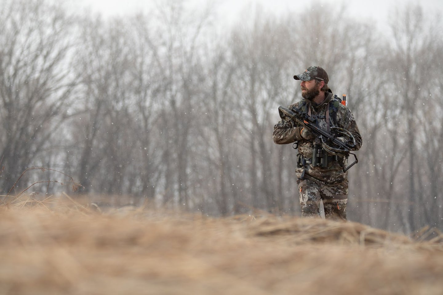 hunter walking with crossbow