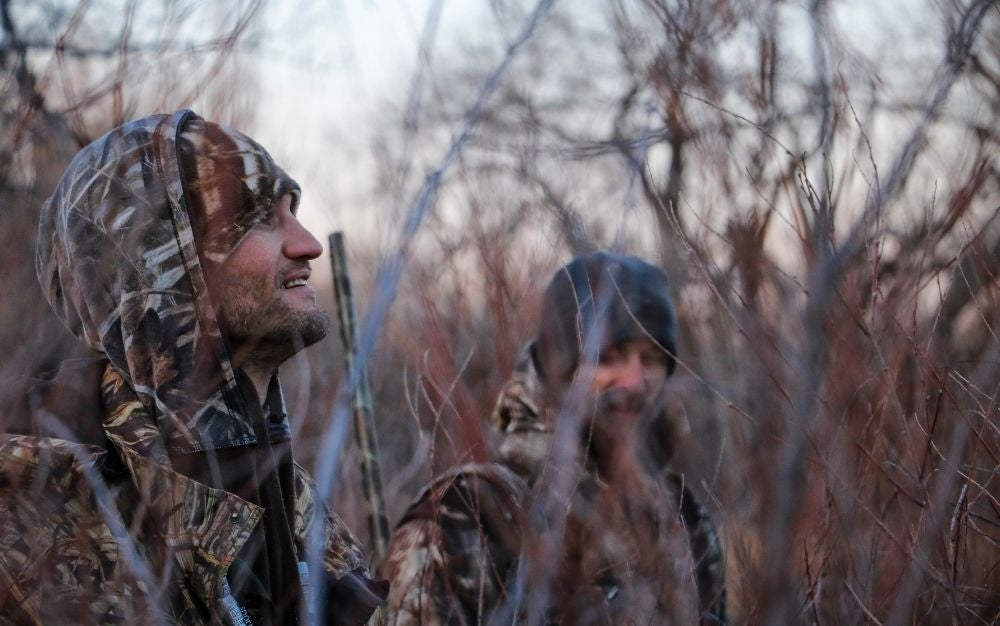 Hunters wearing camouflage.