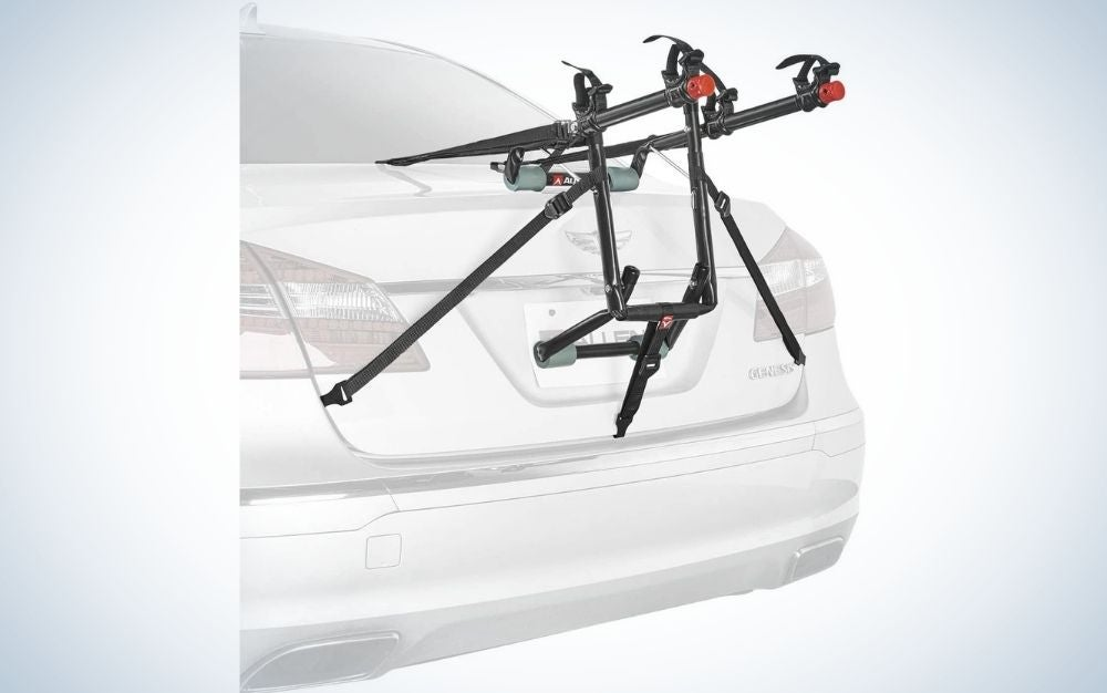 Some black bars fixed to the rear of the car, supported on its license plate as well, which are used to hold the bicycles on the car and to transport them.
