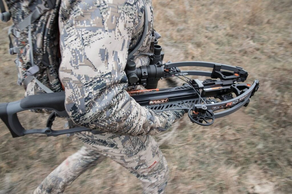 Hunter hiking and carrying Ravin R10