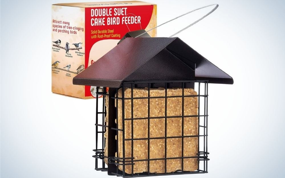 A red box with inscription and instructions on how to store the product in it, as well as a small house to keep the food of the birds in it.