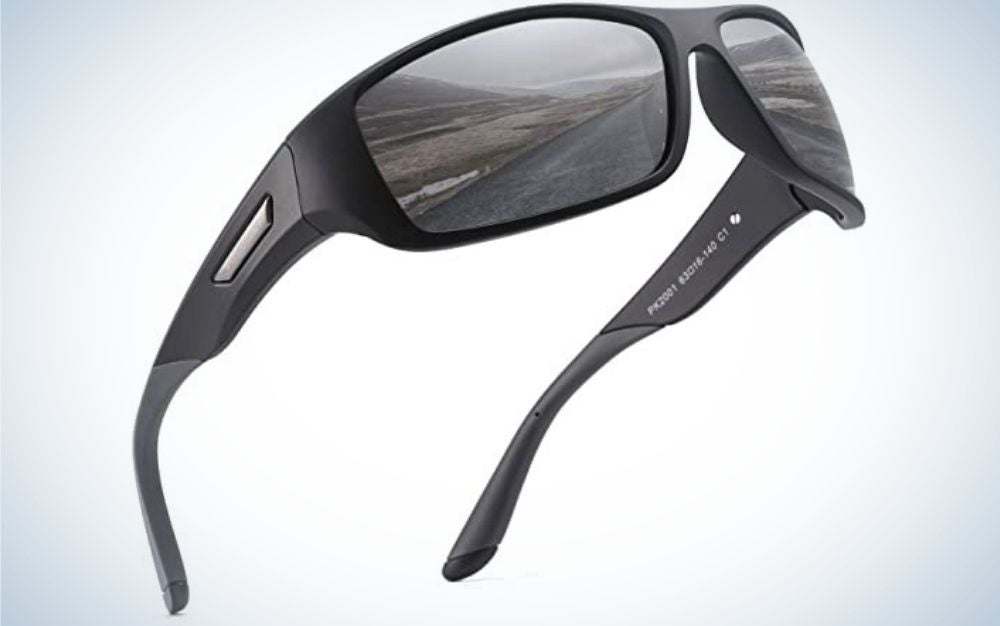 A pair of black sports glasses and a skeleton arch as well as a reflection on their windows.
