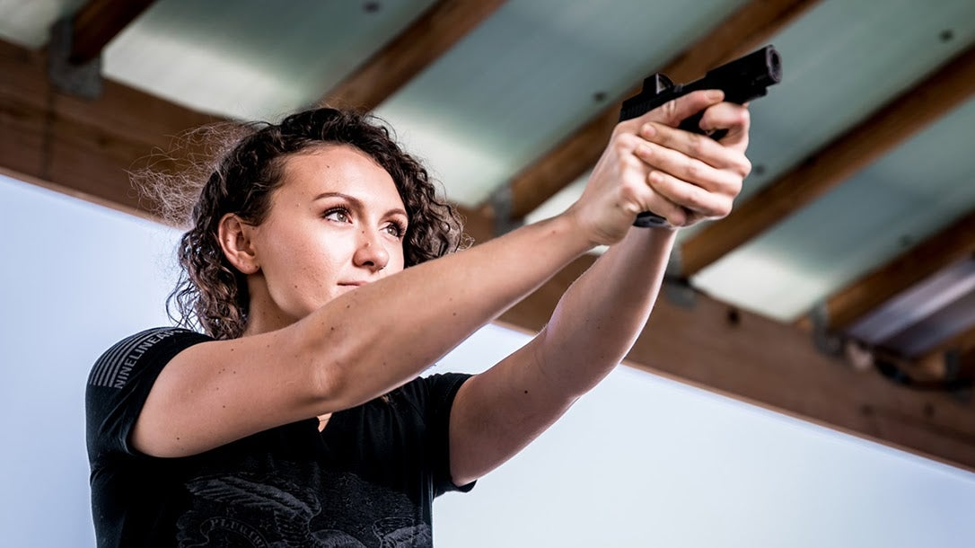 Woman shooting semi-auto handgun