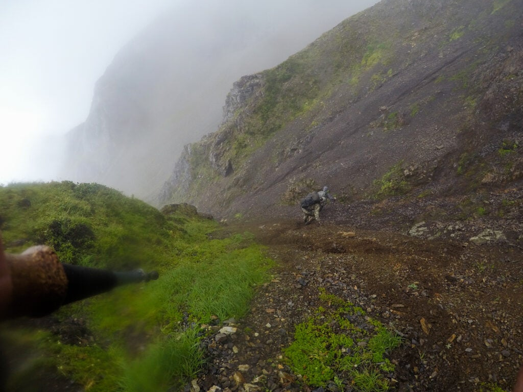 Hunters climbing down a mountain in Alaska.