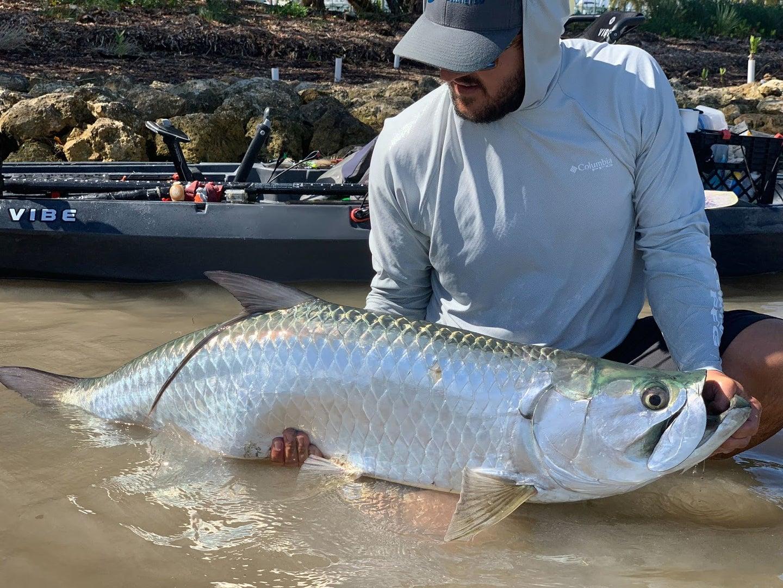 Fisherman holding tarpon