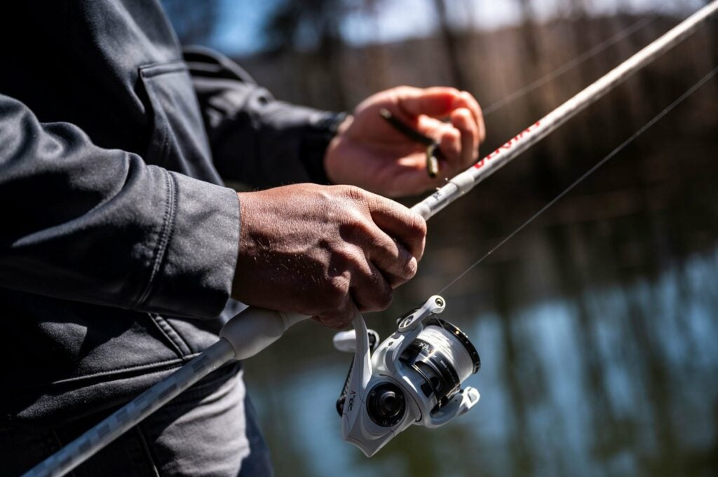 Prepping a spinning reel to cast.
