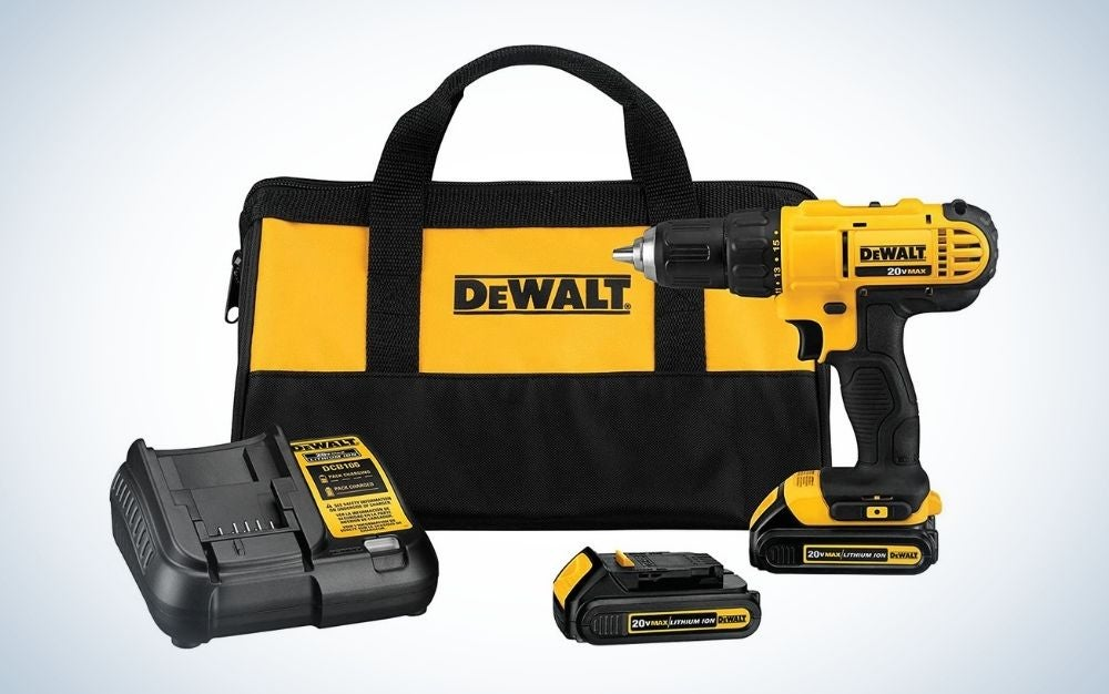 Black and yellow, cordless drill and driver kit with battery powered