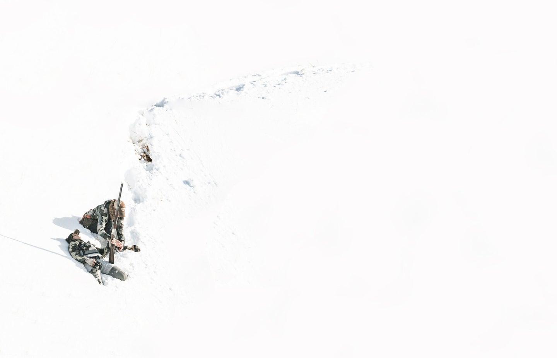 Hunting ptarmigan in the unseasonable snow on Adak.
