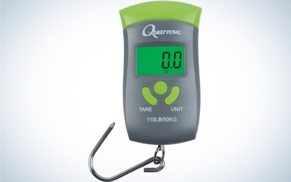 A digital fishing scale all like a small green remote control with a small screen with numbers on it.