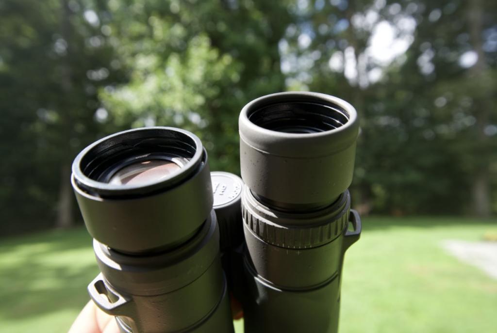 A pair of vortex razor hd binoculars with one rubber eyecup gasket