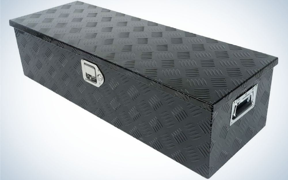 A wide box in the shape of a large rectangle which is all black and in the middle and on the side there are two silver holders.