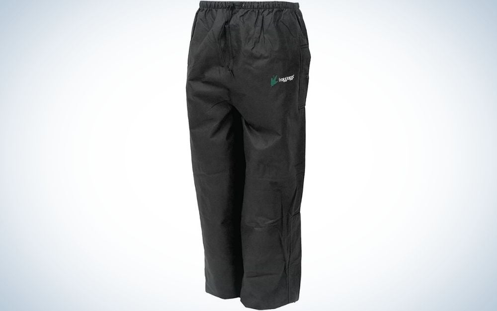 A pair of long pants and black color with the name of the brand beside them.