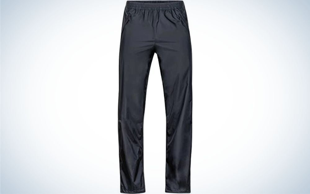 A pair of light gray long pants and material that has shine.