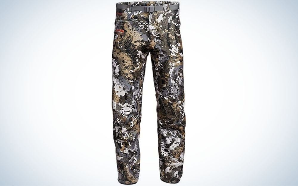 A pair of long pants with a belt as well as military color.