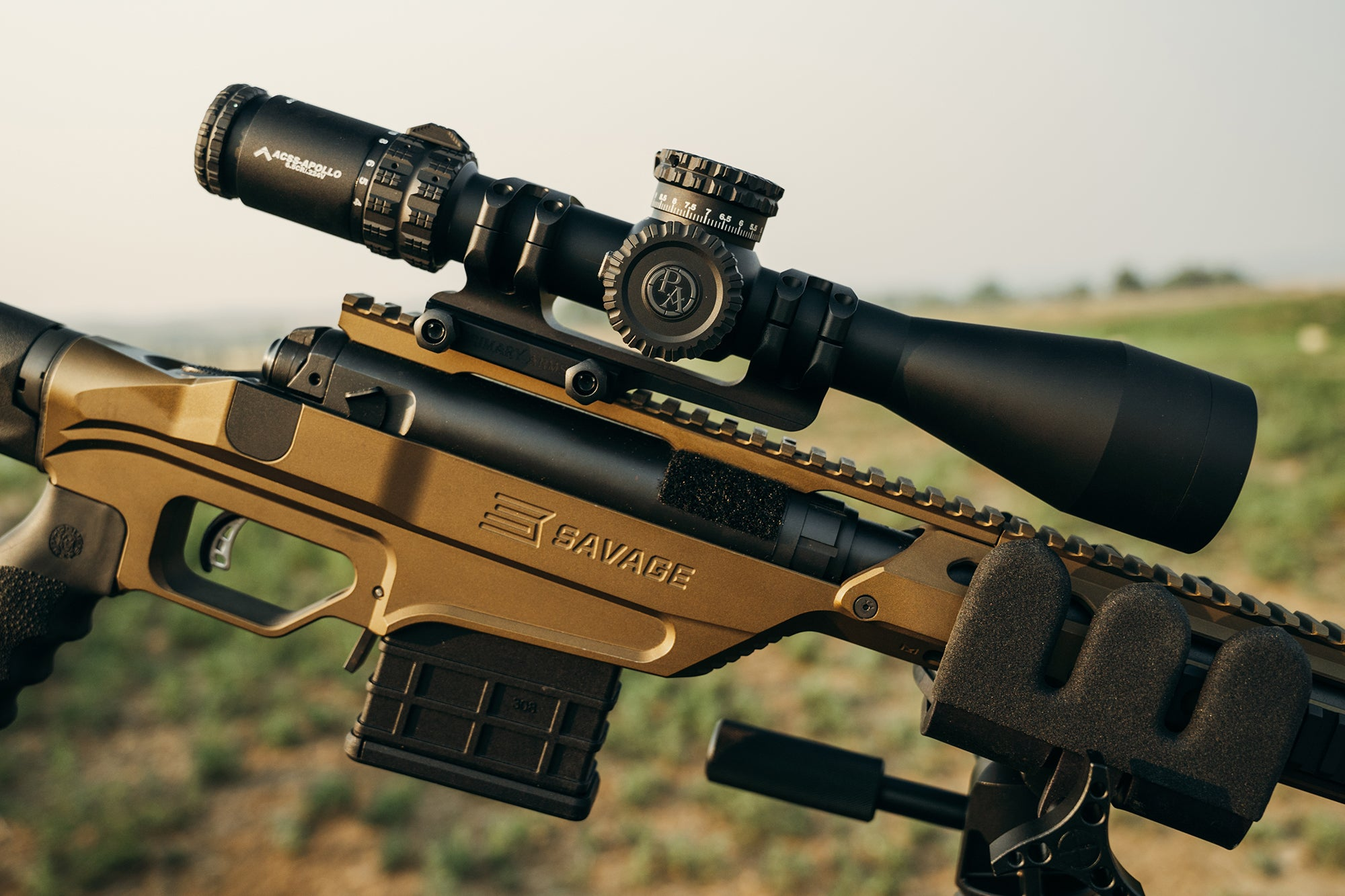 Primary Arms scope atop a gold rifle