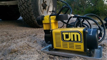 A tire inflator fills a tire.