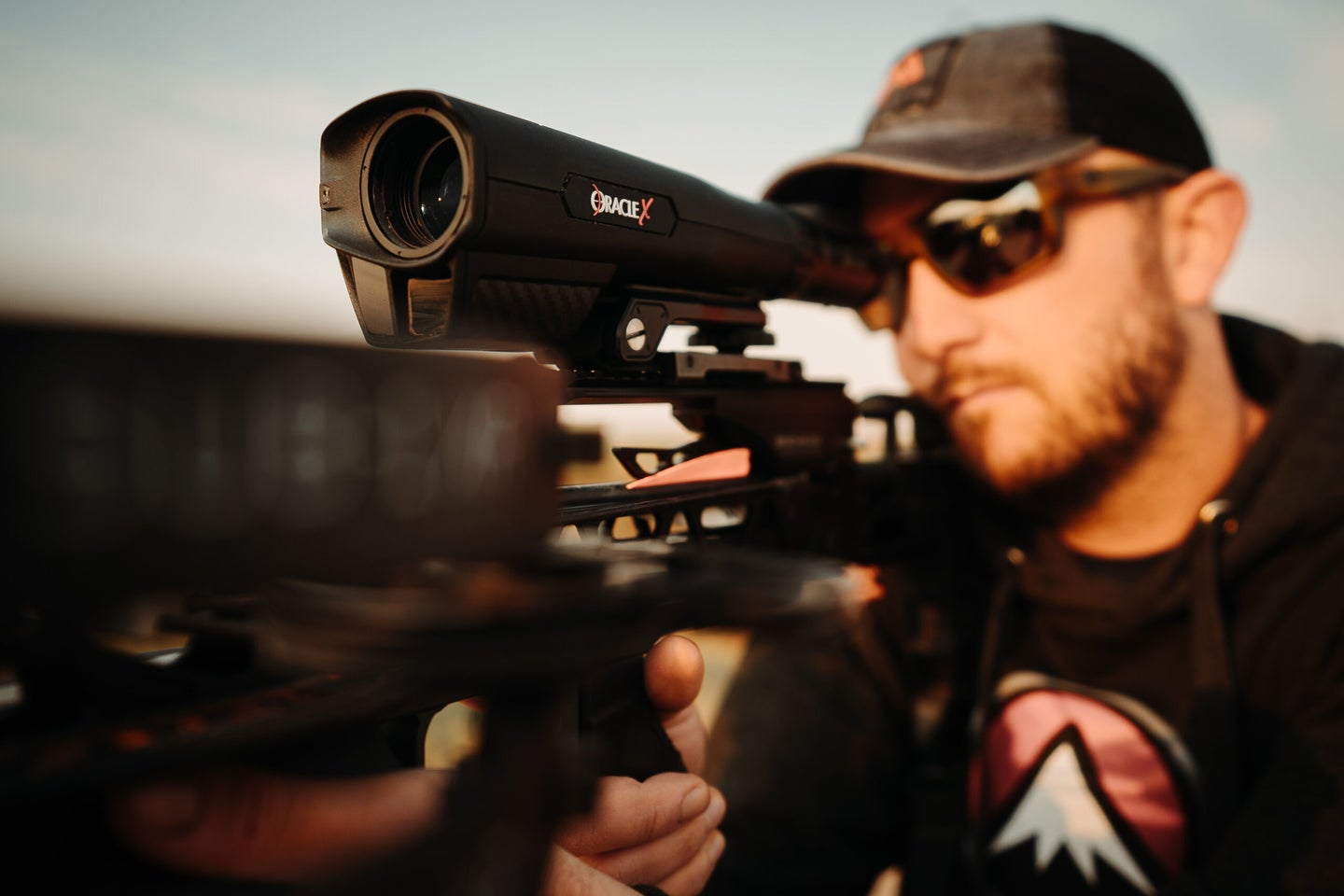 A hunter looks through the Burris Oracle X mounted on a crossbow