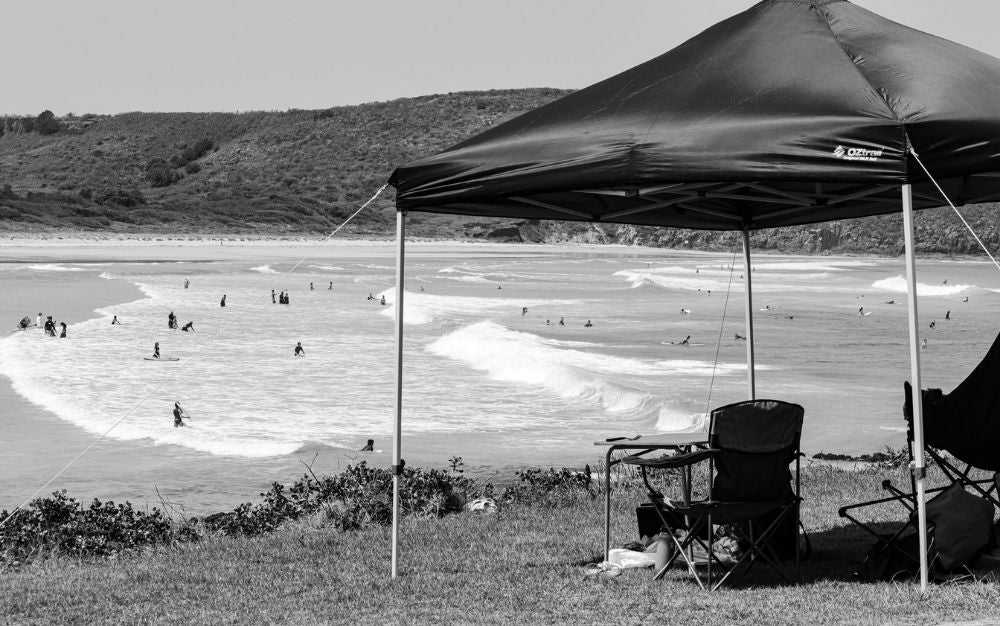 A canopy tent above a beach.