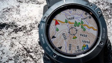 A Garmin Fenix 6 with a GPS map projected on its screen