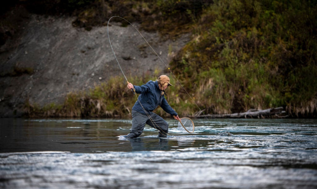 Woman nets her own fish on the fly in Alaska