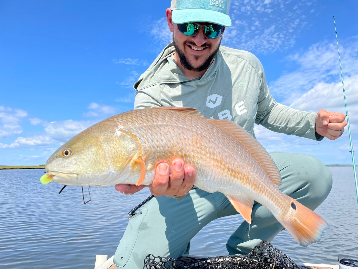 A man holding a redfish
