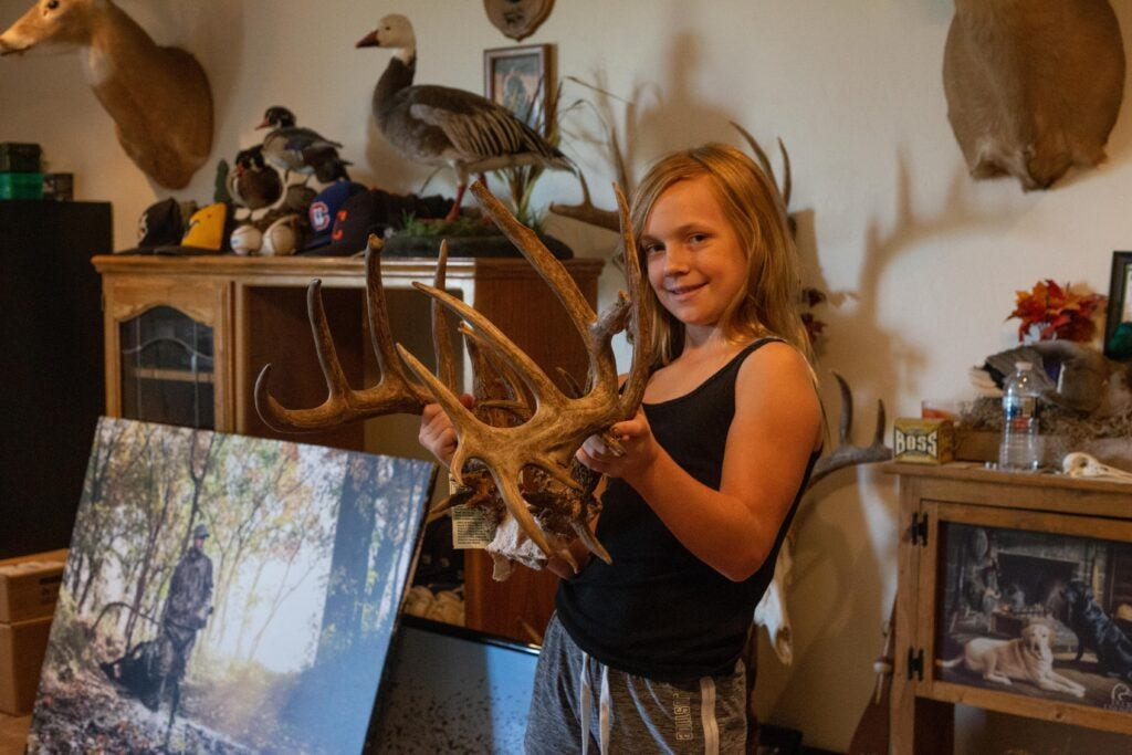 Ell Perkins hold up the rack from her 200-inch whitetail.