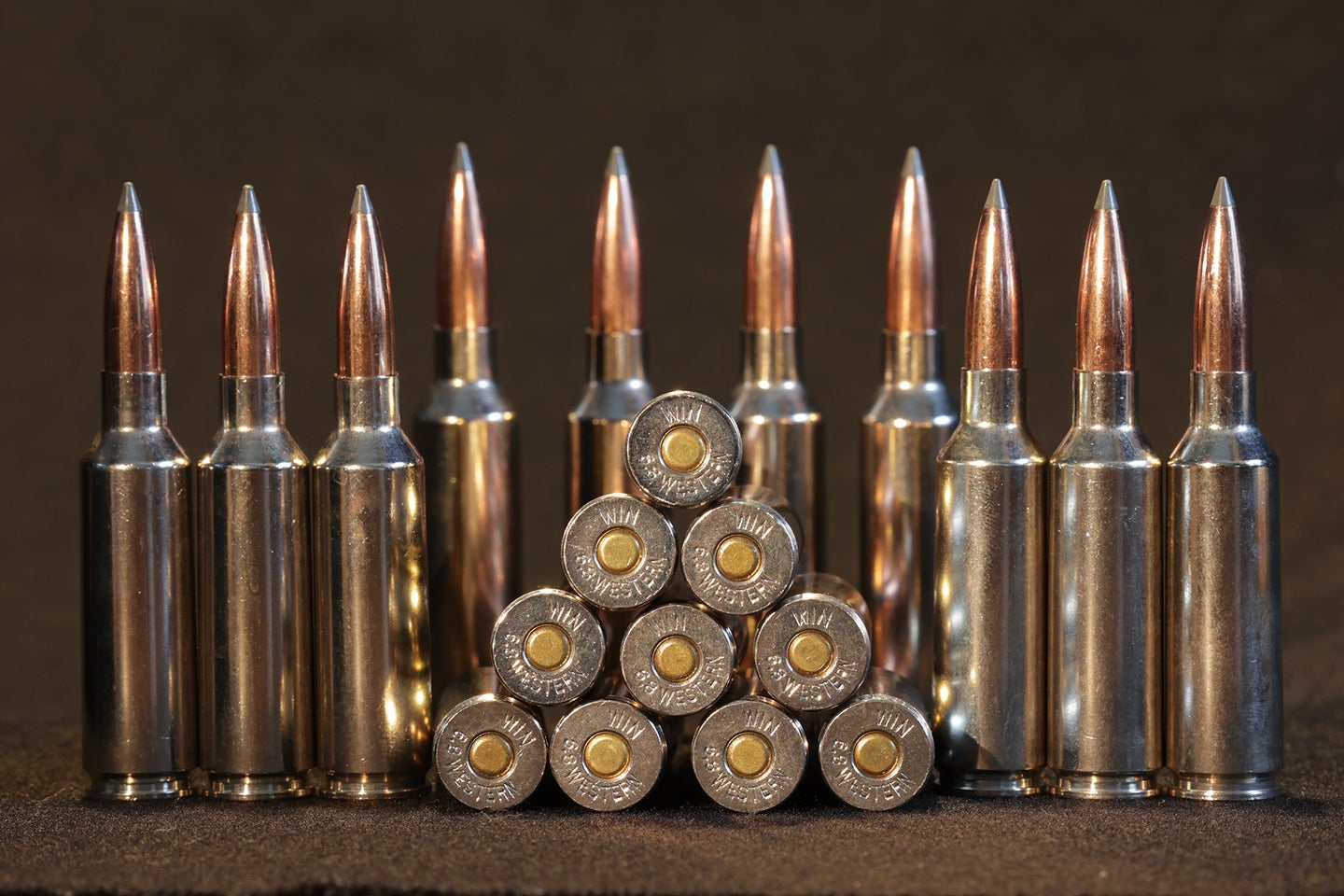 Stack of 6.8 Western hunting cartridges.