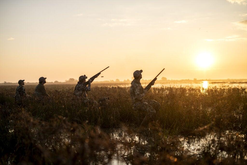 Four men testing the best duck hunting shotguns